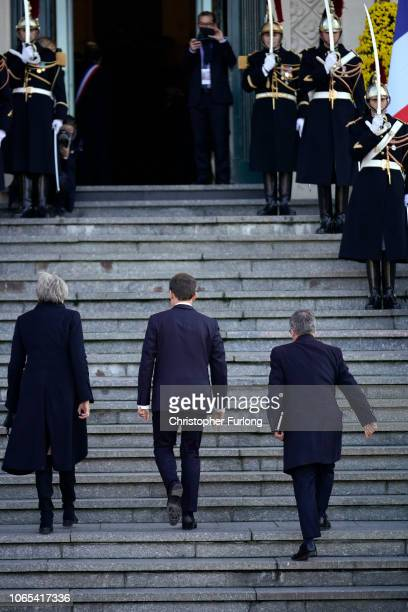 British Prime Minister Theresa May and French President Emmanuel Macron walk the steps of Albert Town Hall as the arrive for a meeting in the region...