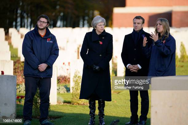 British Prime Minister Theresa May and French President Emmanuel Macron speak with Olivia Smith and James Tanner centenary interns for the...