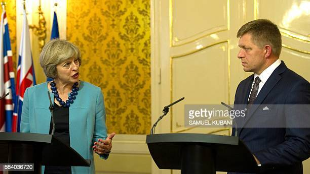 British Prime Minister Theresa May and her counterpart Slovak Prime Minister Robert Fico give a joint press conference after their meeting in...