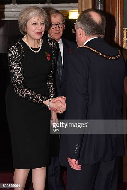 British Prime Minister Theresa May and her husband Philip arrive at the Royal Albert Hall during the annual Royal Festival of Remembrance in central...