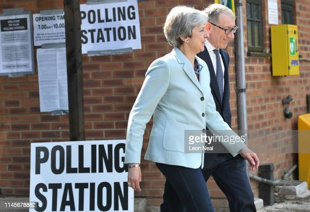 British Prime Minister Theresa May and her husband Philip at her local constituency polling station to vote in the European Elections on May 23 2019...
