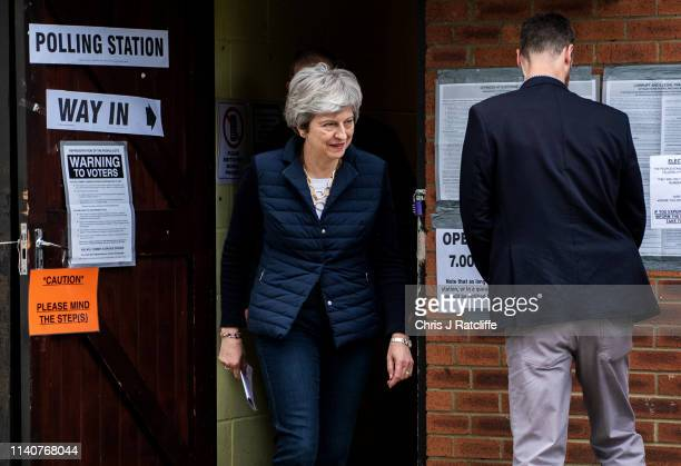 British Prime Minister Theresa May and her husband Philip leave after casting their votes at a polling station in the local council elections on May...