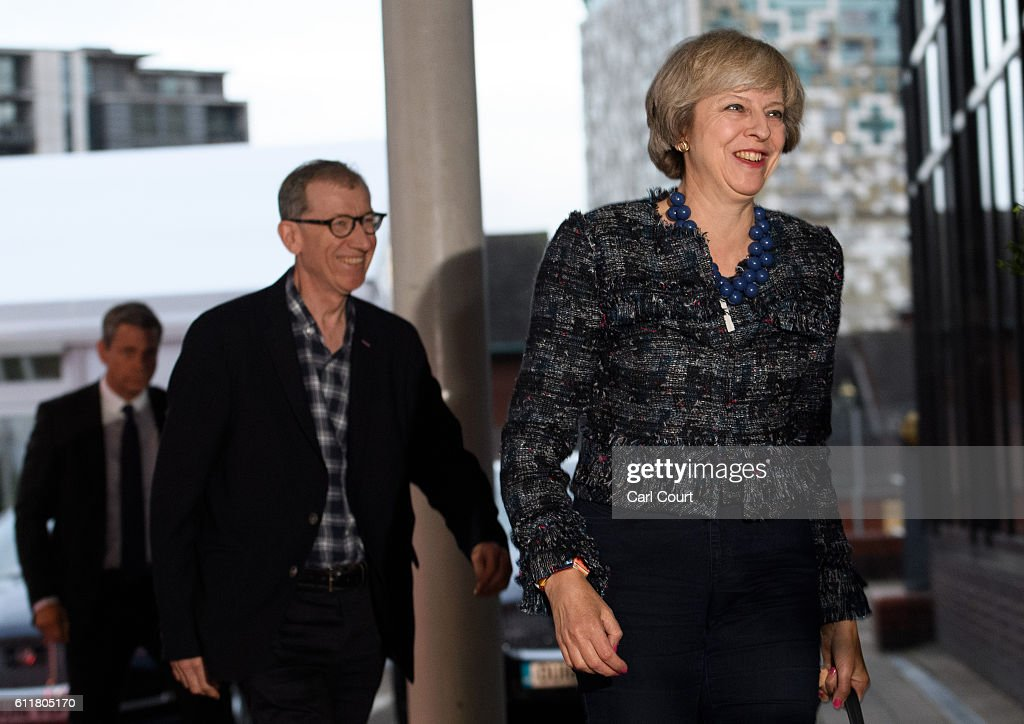 British Prime Minister Theresa May and her husband Philip May (L) arrive at their hotel for the 2016 Conservative Party Conference, on October 1, 2016 in Birmingham, England. Conservative Party members begin gathering today ahead of the four day conference which will begin tomorrow.
