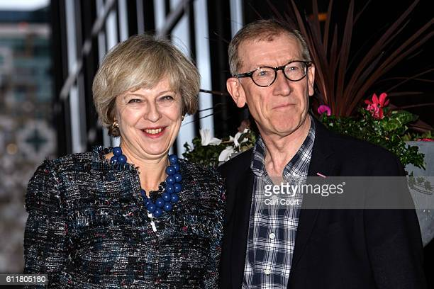 British Prime Minister Theresa May and her husband Philip May arrive at their hotel for the 2016 Conservative Party Conference on October 1 2016 in...