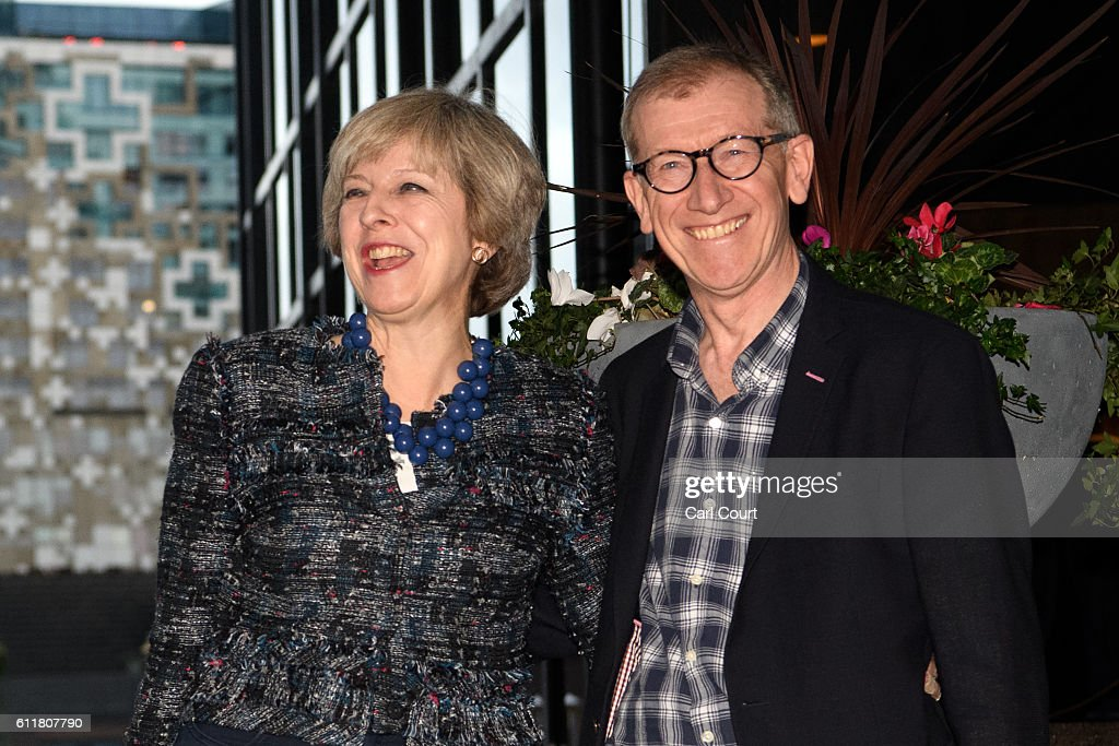 British Prime Minister Theresa May and her husband Philip May arrive at their hotel for the 2016 Conservative Party Conference, on October 1, 2016 in Birmingham, England. Conservative Party members begin gathering today ahead of the four day conference which will begin tomorrow.