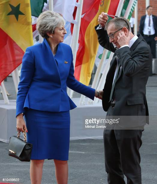 British Prime Minister Theresa May and her husband Philip May arrive to the Elbphilharmone for the dinner during the G20 Summit on July2017 in...