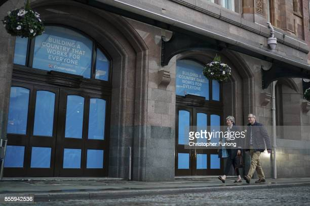 British Prime Minister Theresa May and her husband Philip May arrive at the Midland Hotel on the eve of the 2017 annual Conservative Party Conference...
