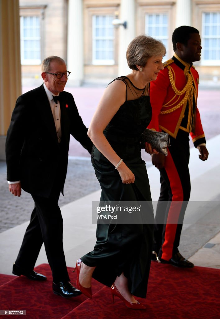 British Prime Minister Theresa May and her husband Philip May (L) arrive for The Queen's Dinner during the Commonwealth Heads of Government Meeting at Buckingham Palace on April 19, 2018 in London, England.