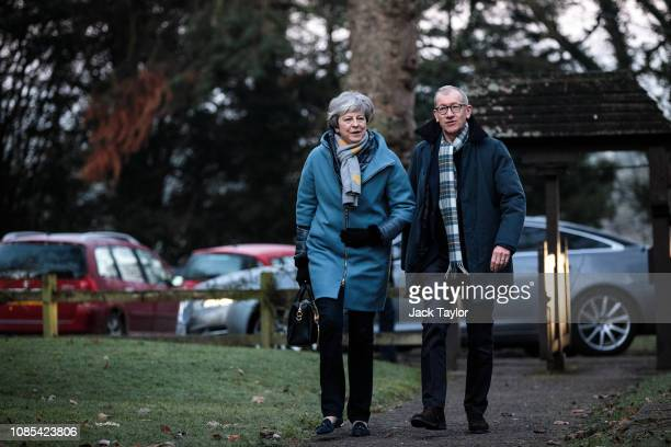 British Prime Minister Theresa May and her husband Philip May attend a Sunday church service on January 20 2019 in Aylesbury England A group of MPs...