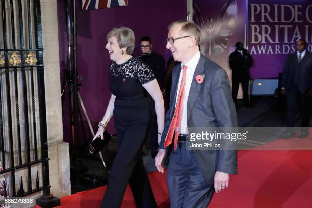 British Prime Minister Theresa May and her husband Philip May attend the Pride Of Britain Awards at Grosvenor House on October 30 2017 in London...