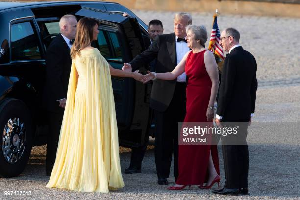 British Prime Minister Theresa May and her husband Philip May greet US President Donald Trump and First Lady Melania Trump at Blenheim Palace on July...
