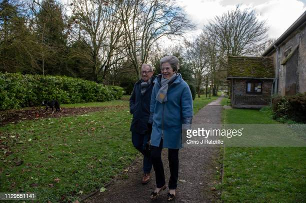 British Prime Minister Theresa May and her husband Philip May leave after attending a church service on March 10 2019 in Aylesbury United Kingdom The...