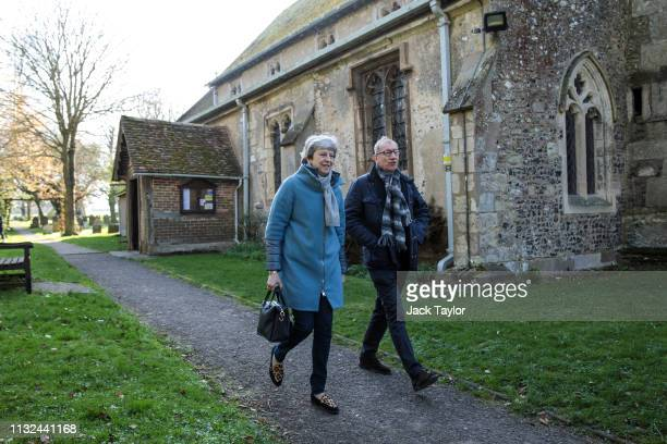 British Prime Minister Theresa May and her husband Philip May leave following a church service on March 24 2019 in Aylesbury England Mrs May is...
