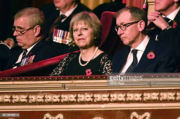British Prime Minister Theresa May and her husband Philip sit alongside Prince Andrew Duke of York at the annual Royal Festival of Remembrance at the...