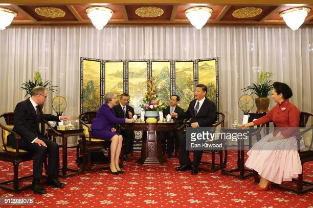British Prime Minister Theresa May and her husband Philip take part in a Tea Ceremony with Chinese President Xi Jinping and his wife Peng Liyuan at...