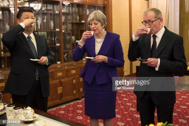 British Prime Minister Theresa May and her husband Philip take part in a Tea Ceremony with Chinese President Xi Jinping at Mr Jinping's official...