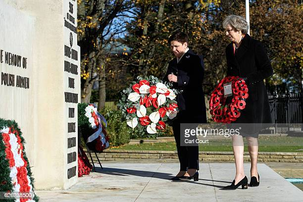 British Prime Minister Theresa May and her Polish counterpart Beata Szydlo lay wreaths during their visit to the Polish War Memorial on November 28...