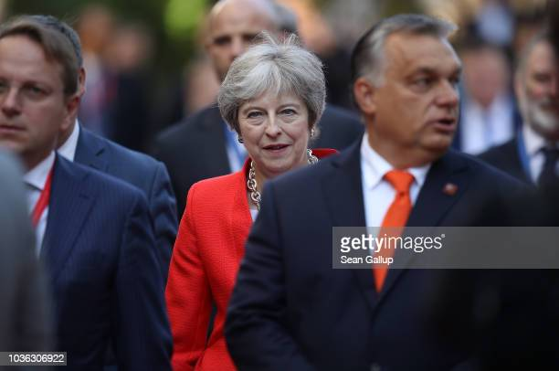 British Prime Minister Theresa May and Hungarian Prime Minister Viktor Orban arrive for the first working session of leaders of the European Union on...