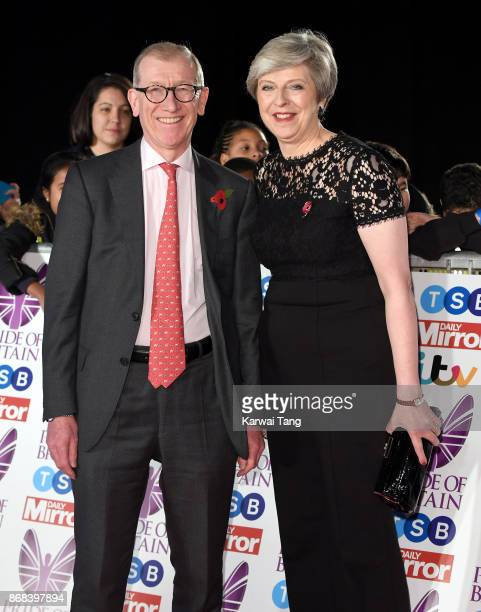 British Prime Minister Theresa May and husband Philip May attend the Pride Of Britain Awards at the Grosvenor House on October 30 2017 in London...