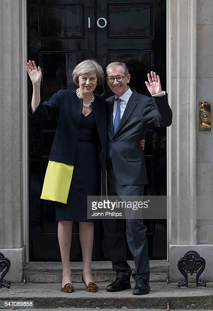 British Prime Minister Theresa May and husband Philip May pose outside 10 Downing Street on July 13 2016 in London England Former Home Secretary...