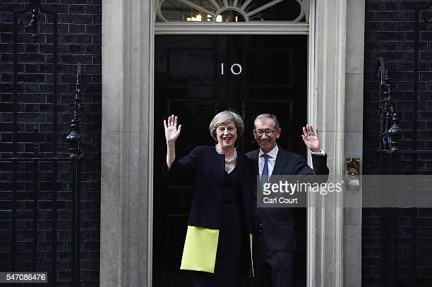 British Prime Minister Theresa May and husband Philip May wave outside 10 Downing Street on July 13 2016 in London England Former Home Secretary...