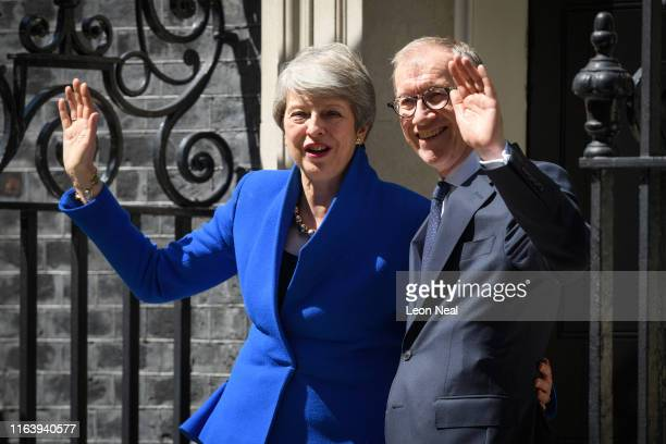 British Prime Minister Theresa May and husband Philip stand on the doorstep for the final time after she made her final address to the public on...