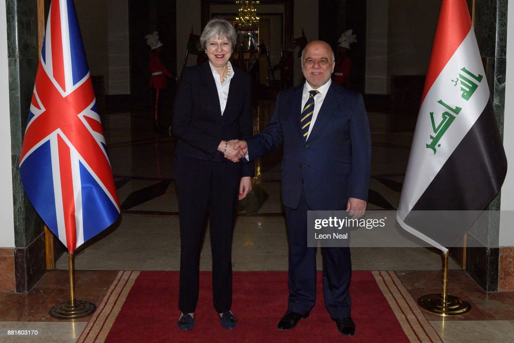 British Prime Minister Theresa May (L) and Iraqi Prime Minister Haider Al-Abadi pose for photographs ahead of a bi-lateral meeting in the Government Palace on November 29, 2017 in Baghdad, Iraq. Theresa May has made a surprise visit to Iraq during a planned visit to the Middle East.
