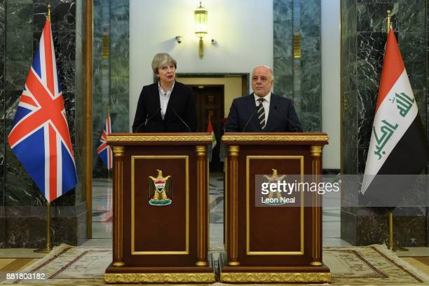 British Prime Minister Theresa May and Iraqi Prime Minister Haider AlAbadi make statements to the media following a bilateral meeting in the...