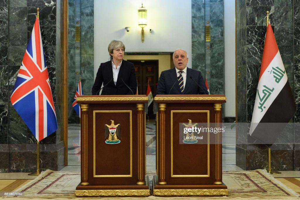 British Prime Minister Theresa May (L) and Iraqi Prime Minister Haider Al-Abadi make statements to the media following a bi-lateral meeting in the Government Palace on November 29, 2017 in Baghdad, Iraq. Theresa May has made a surprise visit to Iraq during a planned visit to the Middle East.
