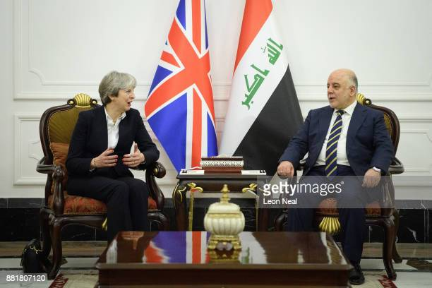 British Prime Minister Theresa May and Iraqi Prime Minister Haider AlAbadi pose for photographs ahead of a bilateral meeting in the Government Palace...