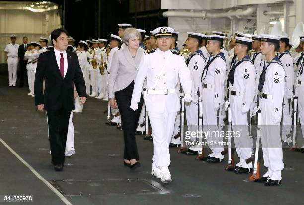 British Prime Minister Theresa May and Japanese Defense Minister Itsunori Onodera attend the welcome ceremony at Japan Maritime SelfDefense Force...