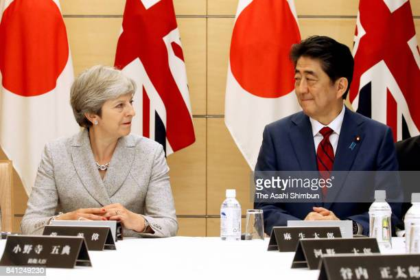 British Prime Minister Theresa May and Japanese Prime Minister Shinzo Abe during a National Security Council meeting at Abe's official residence on...