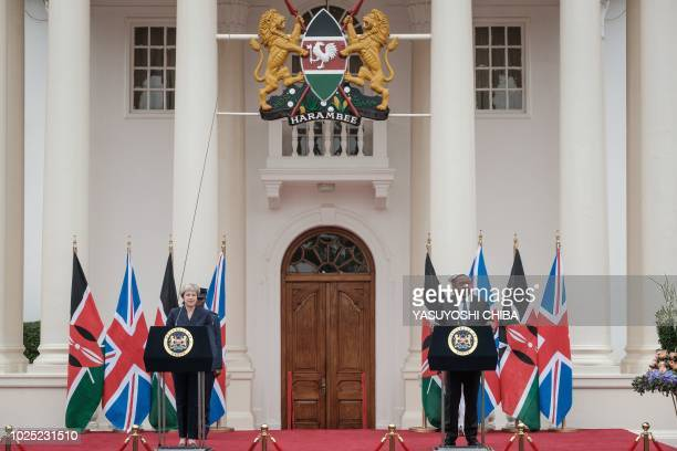 British Prime Minister Theresa May and Kenyan President Uhuru Kenyatta address a joint press conference at the State House in Nairobi on August 30...