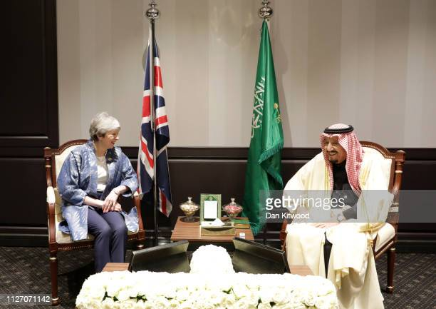 British Prime Minister Theresa May and King Salman bin Abdulaziz Al Saud of Saudi Arabia laugh during their bilateral meeting at the first...