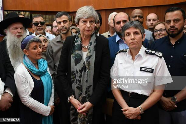 British Prime Minister Theresa May and Metropolitan Police Commissioner Cressida Dick talk to faith leaders at Finsbury Park Mosque on June 19 2017...