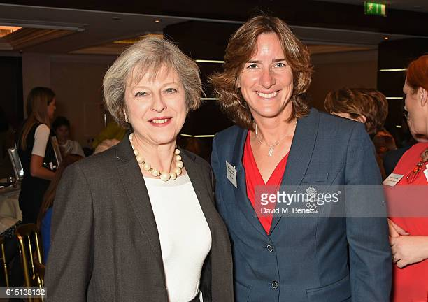 British Prime Minister Theresa May and Olympian Katherine Grainger attend The 61st Women of the Year lunch and awards 2016 at InterContinental Park...