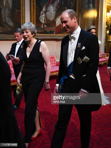 British Prime Minister Theresa May and Prince William Duke of Cambridge arrive through the East Gallery for a State Banquet at Buckingham Palace on...