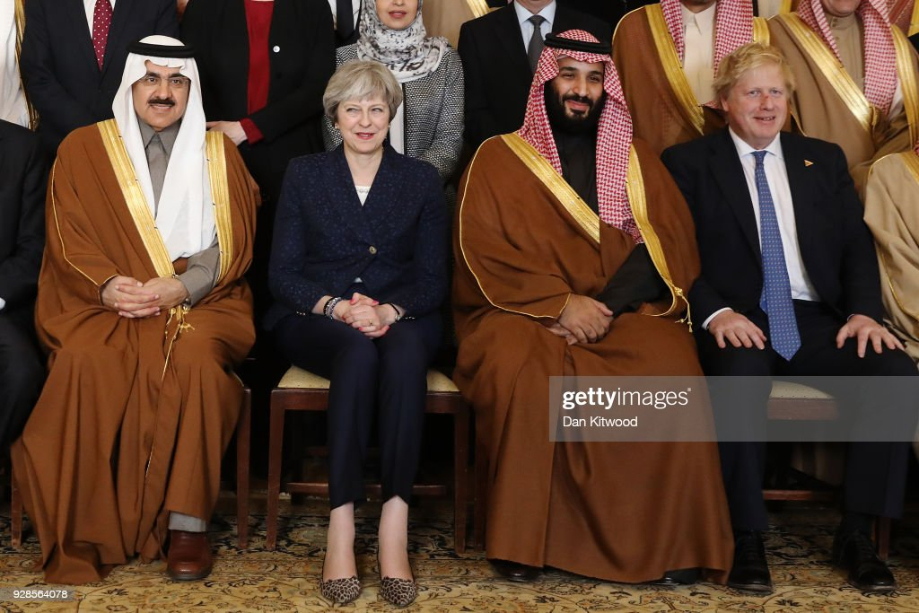 British Prime Minister Theresa May and Saudi Crown Prince Mohammed bin Salman (2nd R) pose for a photograph with other members of the British government and Saudi ministers and delegates inside number 10 Downing Street on March 7, 2018 in London, England. Saudi Crown Prince Mohammed bin Salman has made wide-ranging changes at home supporting a more liberal Islam. Whilst visiting the UK he will meet with several members of the Royal family and the Prime Minister.