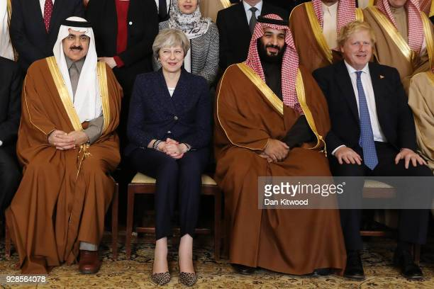 British Prime Minister Theresa May and Saudi Crown Prince Mohammed bin Salman pose for a photograph with other members of the British government and...