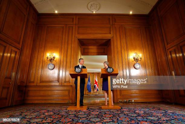 British Prime Minister Theresa May and Secretary General of NATO Jens Stoltenberg hold a press conference inside Number 10 Downing Street on June 21...
