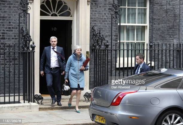 British Prime Minister Theresa May and Secretary of State for Exiting the European Union Stephen Barclay leave Downing Street on March 25 2019 in...