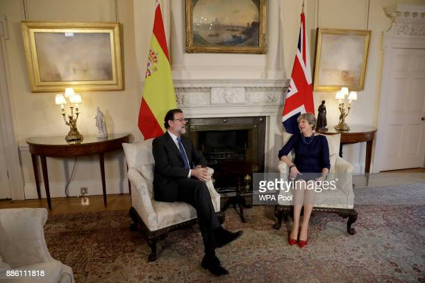 British Prime Minister Theresa May and Spanish Prime Minister Mariano Rajoy speak during a meeting at Downing Street on December 5 2017 in London...
