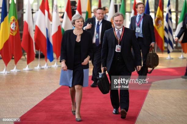 British Prime Minister Theresa May and the EU Ambassador for the UK Tim Barrow arrive at the EU Council headquarters ahead of a European Council...