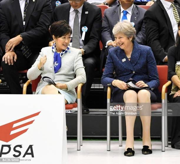 British Prime Minister Theresa May and Tokyo Metropolitan Governor Yuriko Koike watch a game of wheelchair basketball between Great Britain and...
