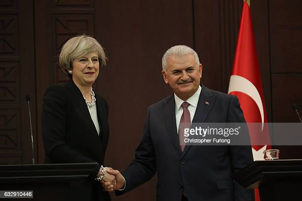 British Prime Minister Theresa May and Turkish Prime Minister Binali Yildirim take part in a press conferencee at his ministerial building on January...