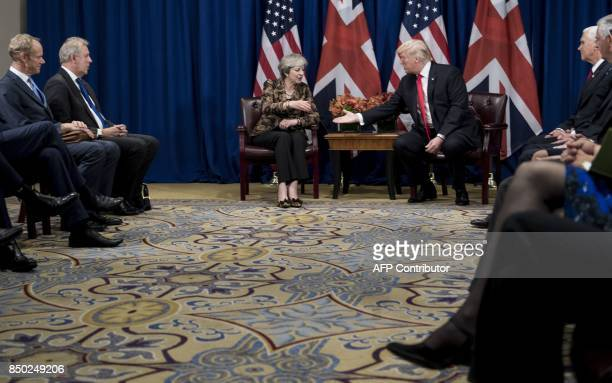 British Prime Minister Theresa May and US President Donald Trump shake hands during a meeting at the Palace Hotel in New York on the sidelines of the...