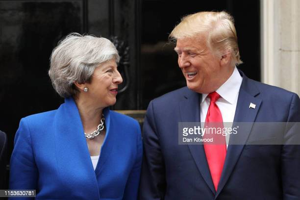 British Prime Minister Theresa May and US President Donald Trump arrive at 10 Downing street for a meeting on the second day of the US President and...