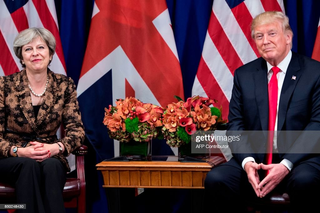British Prime Minister Theresa May and US President Donald Trump wait for a meeting at the Palace Hotel in New York, on the sidelines of the 72nd United Nations General Assembly, on September 20, 2017. / AFP PHOTO / Brendan Smialowski