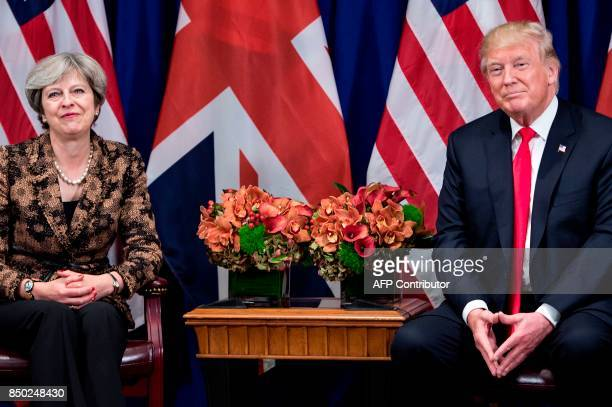 British Prime Minister Theresa May and US President Donald Trump wait for a meeting at the Palace Hotel in New York on the sidelines of the 72nd...