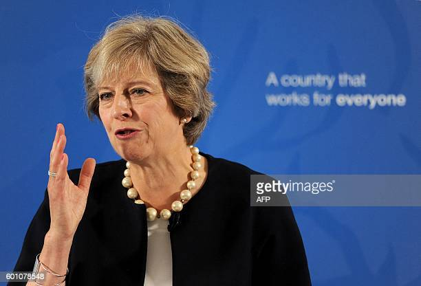 British Prime Minister Theresa May answers questions during a QA session after making a speech at the British Academy in London on September 9 2016...